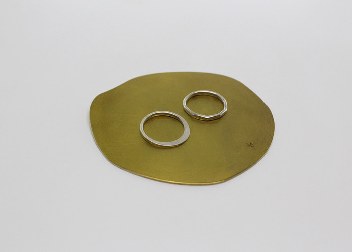 ABSTRACT FLAT COASTER 1. BRASS